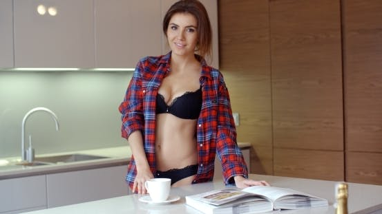Thumbnail for Cute Young Woman In Her Kitchen