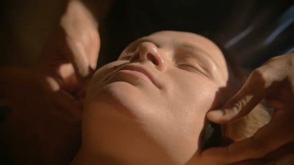 Relaxing Facial Massage With Hot Stones In Beauty