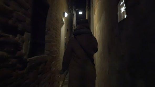 Thumbnail for Woman Running In Narrow Street At Night