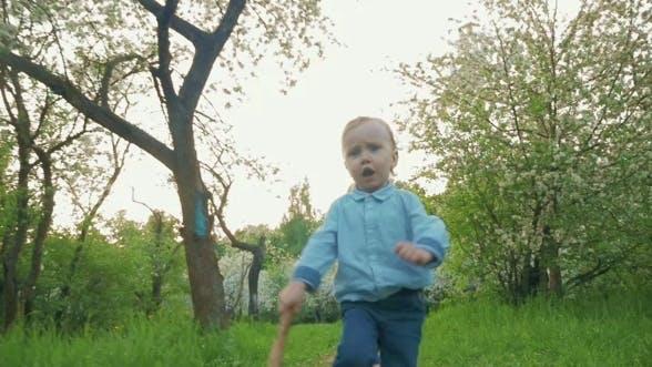 Thumbnail for Little Boy Running Along The Park Alley
