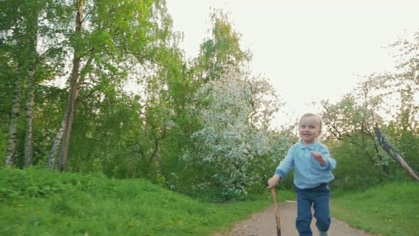 Thumbnail for Happy Child Running On The Path In Park