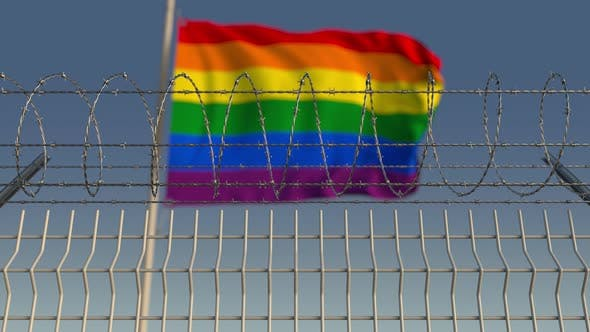 Thumbnail for Barbed Wire Against Blurred Waving Gay Pride Flag