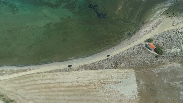 Aerial, Drone View of Cars Driving at Coastal Sand Road in Lemnos, Greece