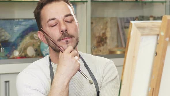 Thumbnail for Professional Artist Concentrating Over His Painting