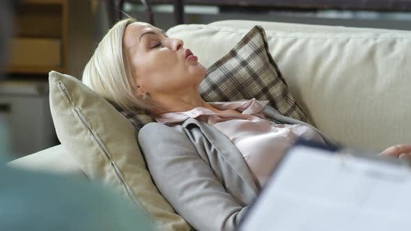 Thumbnail for Blonde Woman Lying on Sofa and Talking to Counselor