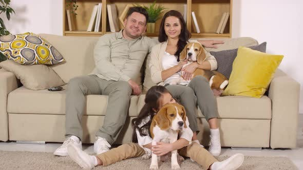 Thumbnail for Portrait of Happy Caucasian Family with Three Cute Dogs in Living Room