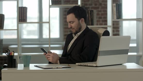Thumbnail for Happy People with Businessman on the Phone Typing Text Message in Office