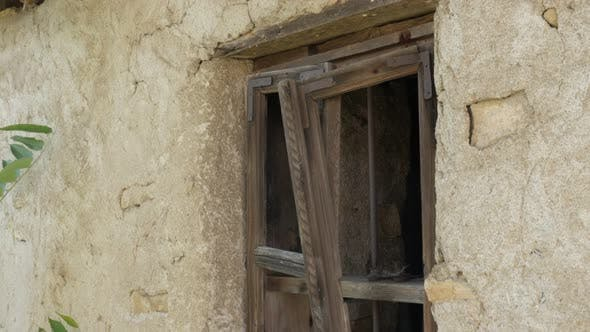 Thumbnail for Abandoned mud house broken windows close-up 4K video