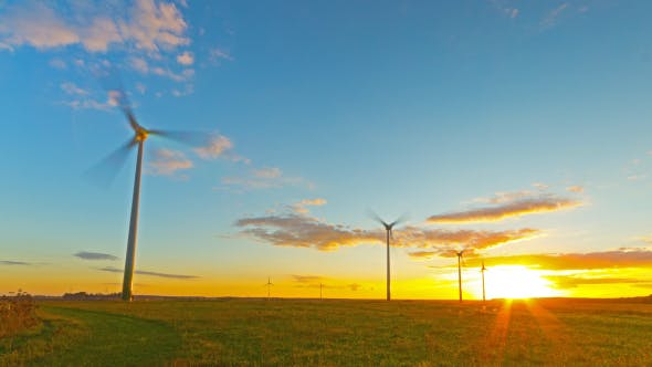Cover Image for Windmills Generators At Sunset