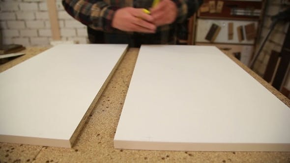Thumbnail for Worker Handles a Wooden Board