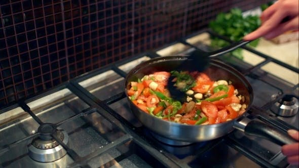 Thumbnail for Cooking Mushrooms With Vegetables In a Frying Pan