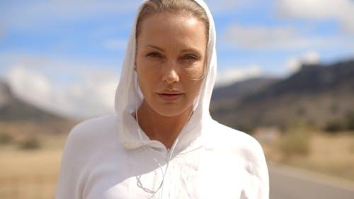 Sporty Girl In White Sweatshirt