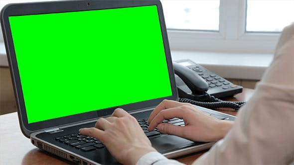 Thumbnail for Woman Typing On Her Laptop with Green Screen