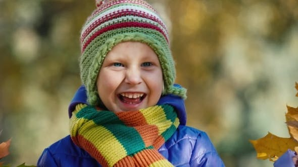 Thumbnail for Little Girl In The Autumn Park Laughing And