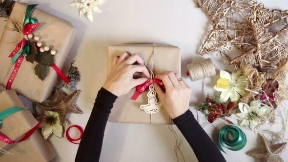 Thumbnail for Woman Wrapping Christmas Presents