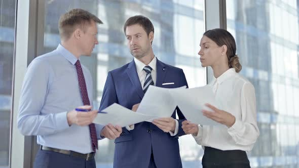 Thumbnail for Executive Business People Sharing Information Through Documents in Boardroom