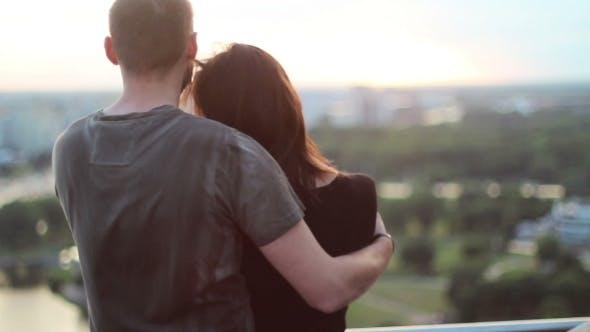 Thumbnail for Beautiful Couple Embrace On Background Of The City