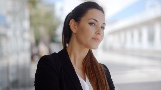 Thumbnail for Beautiful Business Woman Looking At Camera