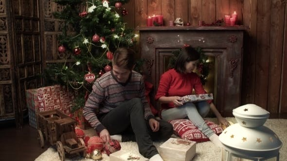 Thumbnail for Mother And The Father Prepare Gifts For Christmas