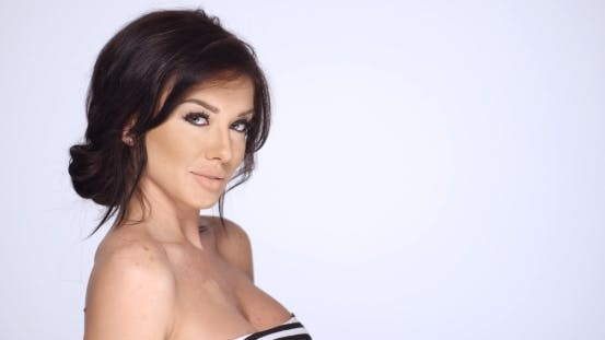 Thumbnail for Sexy Brunette Woman Posing On White