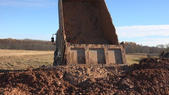 Dumping Dirt or Dump Truck