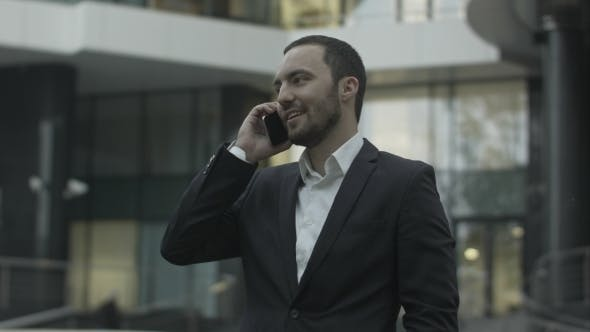 Thumbnail for Happy Businessman Answering Call And Talk