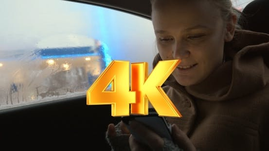 Thumbnail for Woman Using Smartphone In The Car