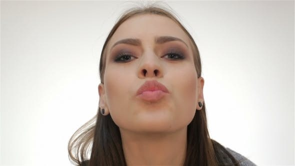 Thumbnail for Attractive Woman Blowing a Kiss