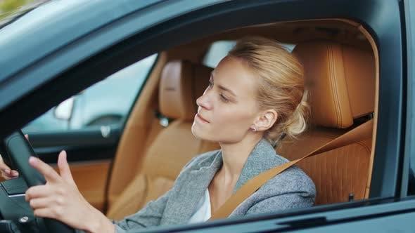 Thumbnail for Closeup Businesswoman Sitting Behind Steering Wheel. Woman Dancing in Car