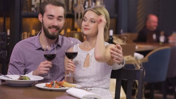 Thumbnail for Engaged Couple With Wine Glasses In Restaurant