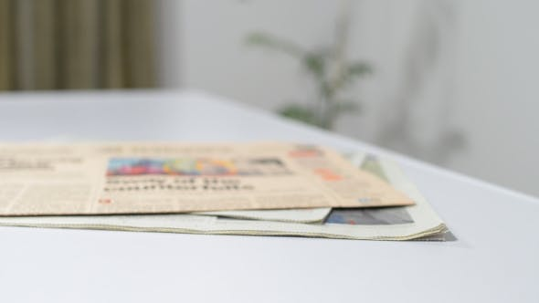 Thumbnail for Putting Newspapers on Table