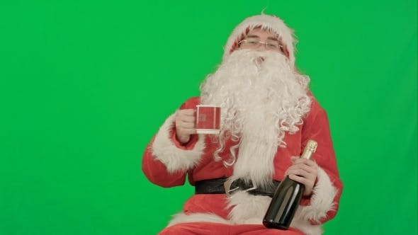 Thumbnail for Santa Claus Celebrating Champagne On a Green