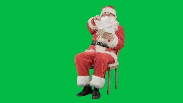 Thumbnail for Santa Claus Sitting On Chair With Letters In Hands