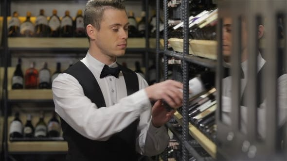 Thumbnail for Sommelier Choosing a Bottle Of Wine At The Wine