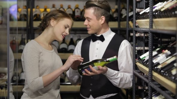 Thumbnail for Confident Male Sommelier Showing Wine Bottle