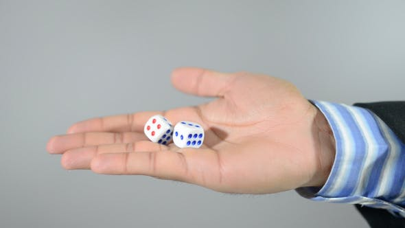 Thumbnail for Man Shaking Dice in Hand