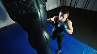 Boxing Workout: Athletic Man Boxing