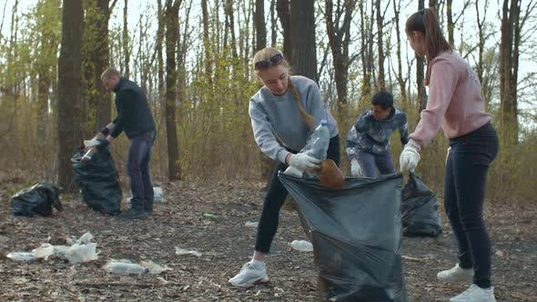 Thumbnail for Volunteers Collecting Garbage in Park