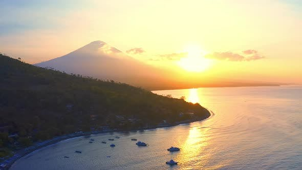 Thumbnail for Amed Black Sand Beach and Volcano Agung at Sunrise and Sunset. Aerial View