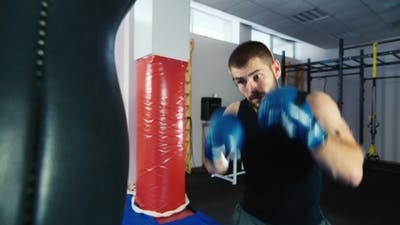 Boxing Workout: Athletic Man Boxing.