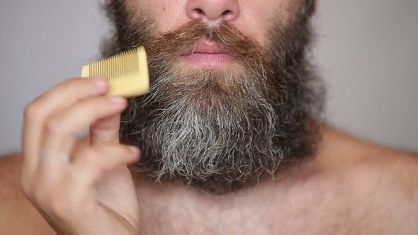 Thumbnail for White Man Taking Care Of His Lush Beard And