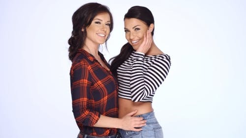Two Brunette Girls In Casual Clothes Posing