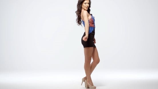 Thumbnail for Gorgeous Shapely Young Woman In a Miniskirt
