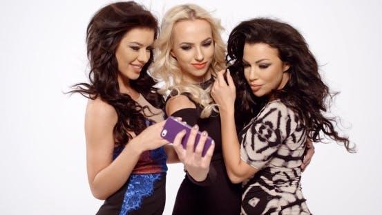 Thumbnail for Gorgeous Ladies Taking Selfie Using Phone