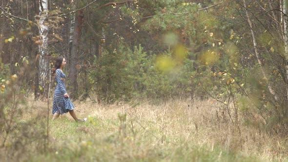 Thumbnail for Girl Walks in Forest