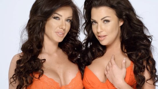 Thumbnail for Two Seductive Ladies In Orange Lingerie