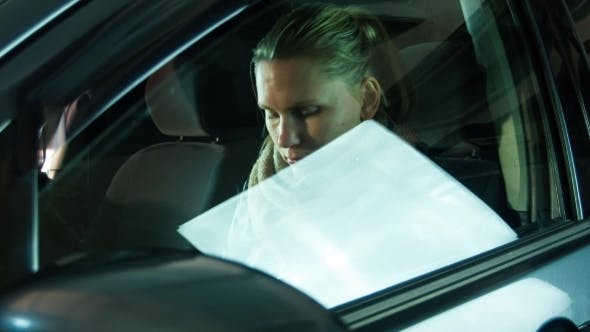 Thumbnail for The Girl Closes a Window In The Car And Starts
