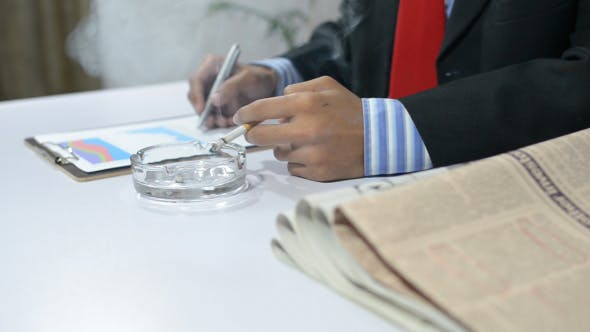 Thumbnail for Smoking Businessman Working in Office