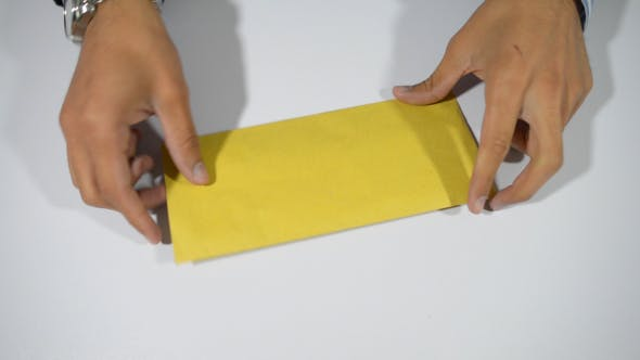 Thumbnail for Hands Opening Envelope and Letter
