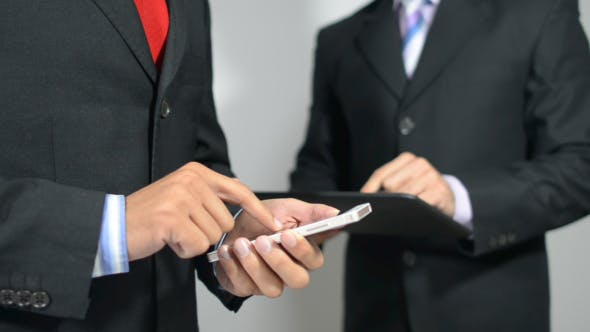 Thumbnail for Businessmen Busy with Smartphone and Tablet